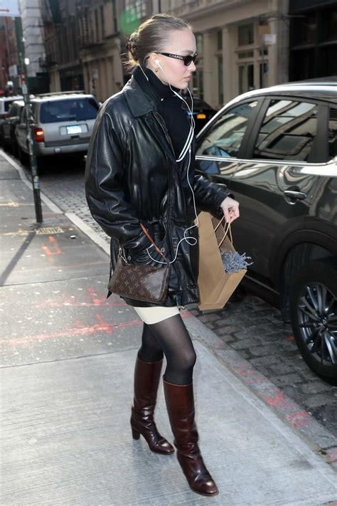 lily-rose depp steps out in a black leather jacket, brown